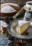Spiced Christmas cake, cup of tea and crocheted snowflakes Royalty Free Stock Image