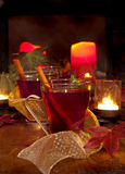 Spiced cider. A closeup of two glasses of reddish spiced cider on a table in a Christmas setting royalty free stock photos