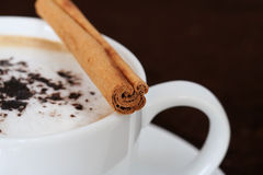 Spiced coffee. A cup of fresh cappucino with cocoa and cinnamon stock photography