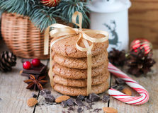 Spiced cookies with almonds. Christmas gifts. Round cookies, tied with ribbon. And spruce branch in a basket on the table stock image
