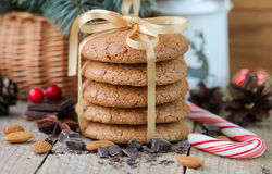 Spiced cookies with almonds. Christmas gifts. Round cookies, tied with ribbon Royalty Free Stock Photo