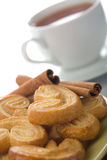 Spiced cookies and tea isolated Royalty Free Stock Image