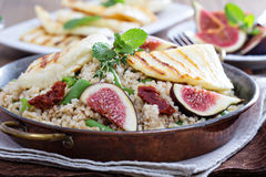 Spiced cous-cous with grilled haloumi Stock Image