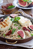 Spiced cous-cous with grilled haloumi Royalty Free Stock Photos