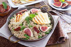 Spiced cous-cous with grilled haloumi. And figs Royalty Free Stock Image