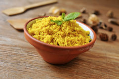 Spiced couscous on a rustic wooden table Royalty Free Stock Image