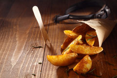 Spiced golden potato wedges Stock Photography