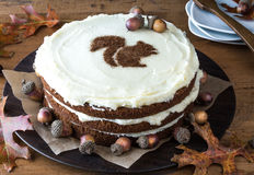 Spiced Layer Cake with Squirrel Stencil. Spiced Layer Cake with icing and cinnamon stenciled squirrel Stock Image