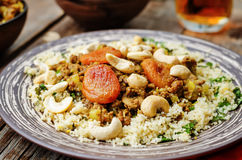 Spiced mince with dried apricots, cashew nuts and couscous. Moro Royalty Free Stock Photography