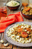 Spiced mince with dried apricots, cashew nuts and couscous. Moro Stock Images