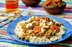 Spiced mince with dried apricots, cashew nuts and couscous Stock Photo