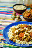 Spiced mince with dried apricots, cashew nuts and couscous Stock Image