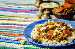 Spiced mince with dried apricots, cashew nuts and couscous Stock Photos