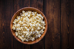 Spiced Popcorn in a Wooden Bowl Stock Images