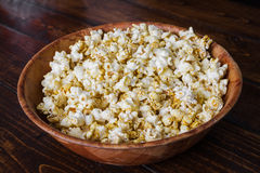 Spiced Popcorn in a Wooden Bowl Royalty Free Stock Photography