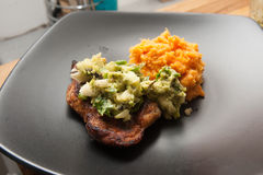 Spiced Pork Chop. S with charred poblano salsa and sweet potato mash royalty free stock photo
