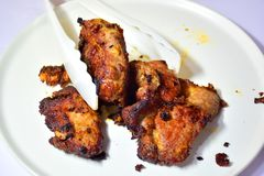 Deep Fried Pork - Place in a container. Spiced Pork Fry in boiling oil, rinse thoroughly until the skin burns Stock Images