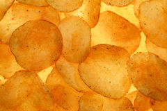 Spiced potato crisps chips background backlit Royalty Free Stock Photo