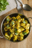 Spiced potato curry. Indian spiced potato curry topped with coriander stock photo