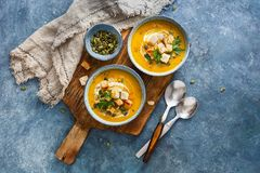 Spiced pumpkin, carrot, and sweet potato soup. Stock Image