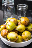 Spiced seckel pears being preserved Stock Photo