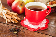 Spiced tea with cinnamon and apples Royalty Free Stock Photography