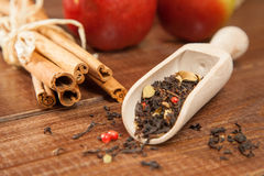 Spiced tea with cinnamon and apples Stock Image