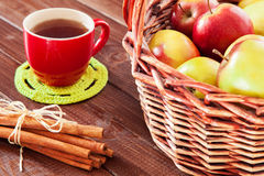Spiced tea with cinnamon and apples Royalty Free Stock Photo