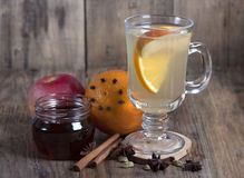 Spiced tea with fruits  and spices in a glass  . Stock Photo