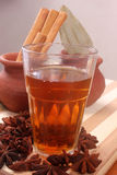 Spiced tea over wood background,Star anise spice fruits in front Royalty Free Stock Images
