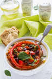 Spiced vegan kidney bean and lentil thick soup with tomatoes and bell pepper. Vintage ceramic bowl on white table Stock Photos
