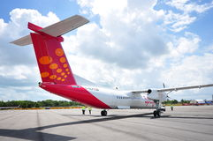 Spicejet's Bombardier Q400 regional aircraft being towed to position at Singapore Airshow 2012 Royalty Free Stock Images