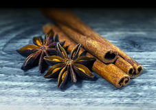 Spicery anis and cinnamon. Christmas dry spicery anis and cinnamon on a wooden background stock photography