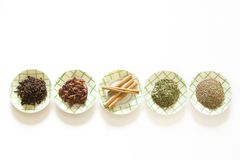 Spices. Varied spices in plates on white background Royalty Free Stock Photo