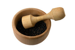 Spices. Wooden capacity for preparation of spices (black pepper inside lies Royalty Free Stock Photography