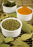 Spices. Marjoram, bay leaf, chili Royalty Free Stock Images