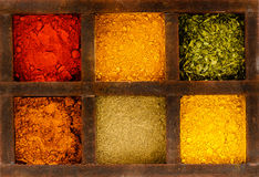 Spices. Image wooden box with different spices Stock Photos