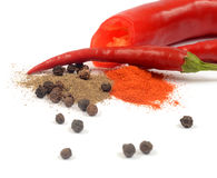 Spices. Black pepper and cayenne peppers Stock Images