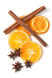 Spices. Dried slices of orange, cinnamon stick and star anise over white background Royalty Free Stock Photo