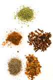 Spices. Clockwise from top: Parsley, cloves, red pepper, black pepper, and paprika stock image