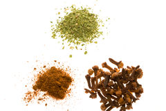 Spices. Parsley, cloves, and paprika. Isolated on white royalty free stock image