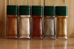 Spices. In the bottles on the table Royalty Free Stock Photos