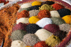 Spices. Assortment of different spices in a bag on a market Royalty Free Stock Images