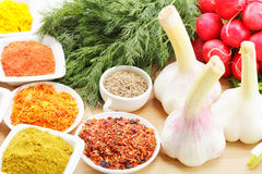 Spices in abundance. And vegetables on wooden board closeup photo Royalty Free Stock Images