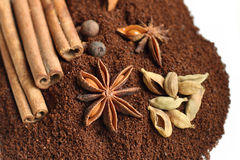 Spices against ground coffee Royalty Free Stock Images