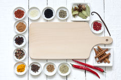 Spices And Dried Vegetables With Cutting Board Royalty Free Stock Photography