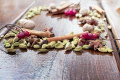 Spices anise, cinnamon, cardamom, whole nutmeg on wooden table. Stock Image