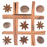 Spices arranged as picture: star anise, nutmeg, cinnamon Royalty Free Stock Images