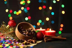 Spices on the Background of Christmas lights garlands Stock Photos