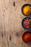 Spices background: pink and black pepper, paprika powder, curry Royalty Free Stock Images